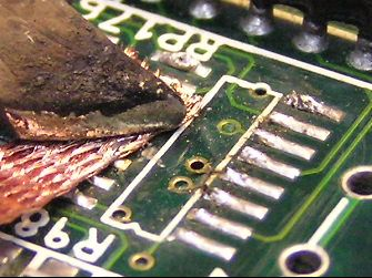 Use solder wick to remove the old solder
